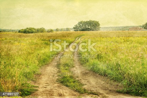 istock Peaceful landscape with country road 471691127