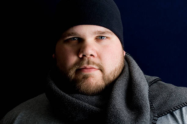 Peaceful man wearing winter clothing stock photo