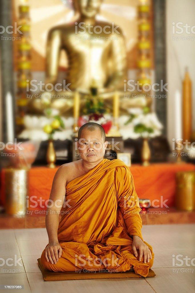 Peaceful monk, meditating Buddha stock photo