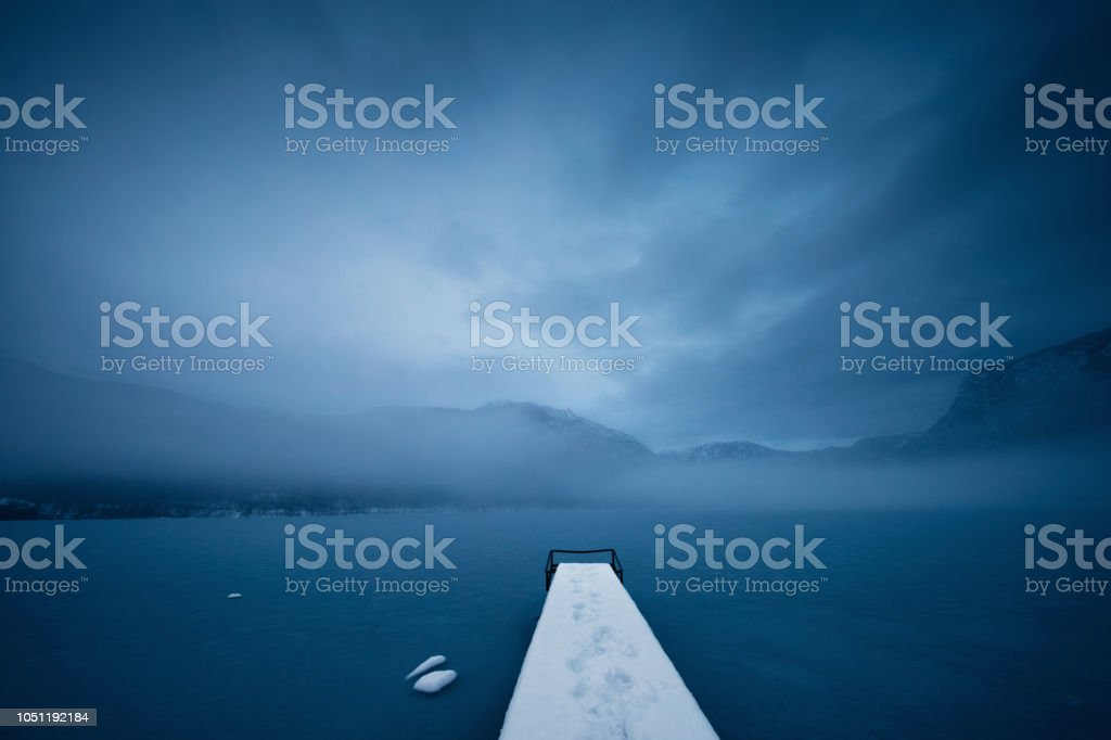 Peaceful Morning By The Frozen Lake stock photo