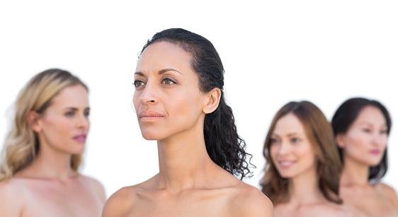 Peaceful nude models posing looking away — Stock Photo
