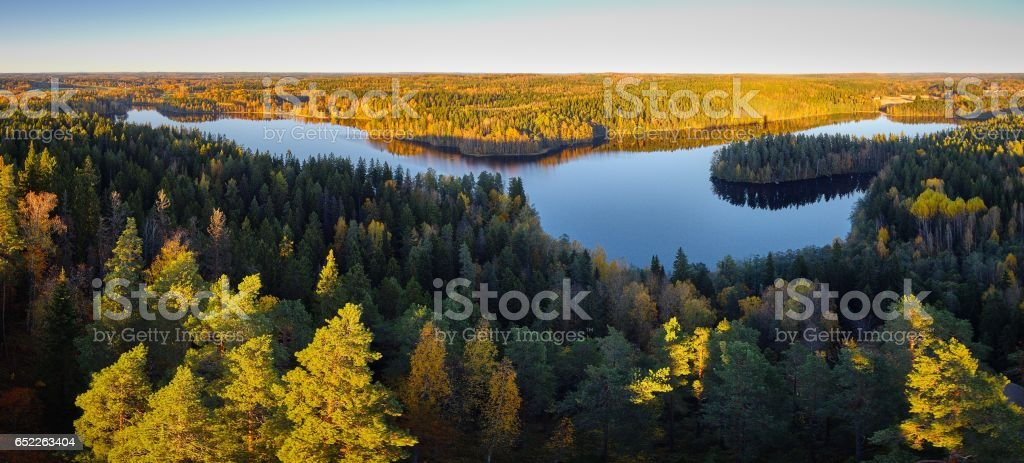 Peaceful panorama lake view with fall colors stock photo