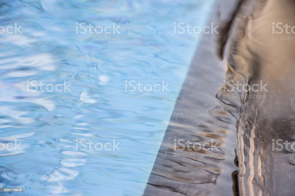 Peaceful pool reflection with unpredictable change stock photo