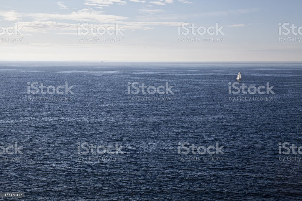Peaceful sailing in a calm ocean royalty-free stock photo