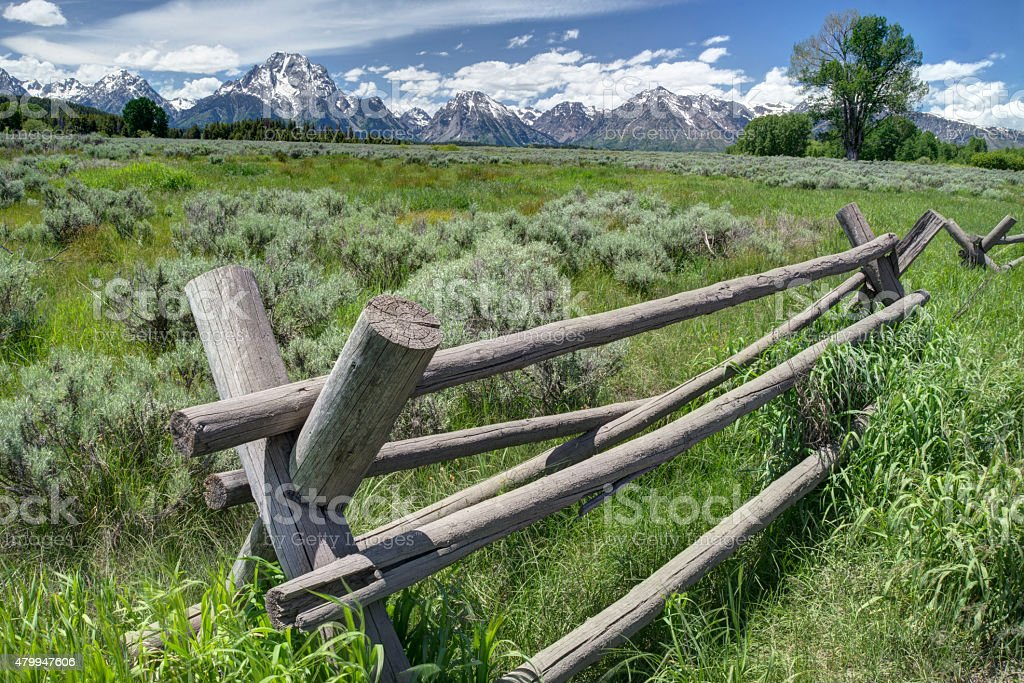 Peaceful scenic of rail fence and sagebrush in Yellowstone. stock photo