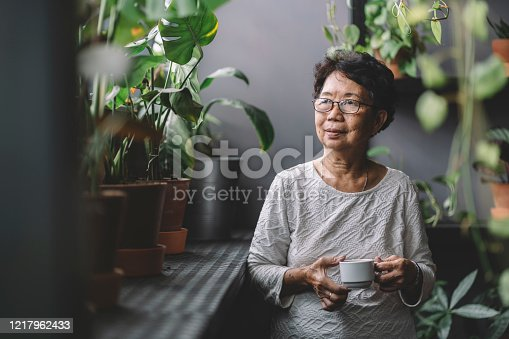 grandmother sitting at home alone