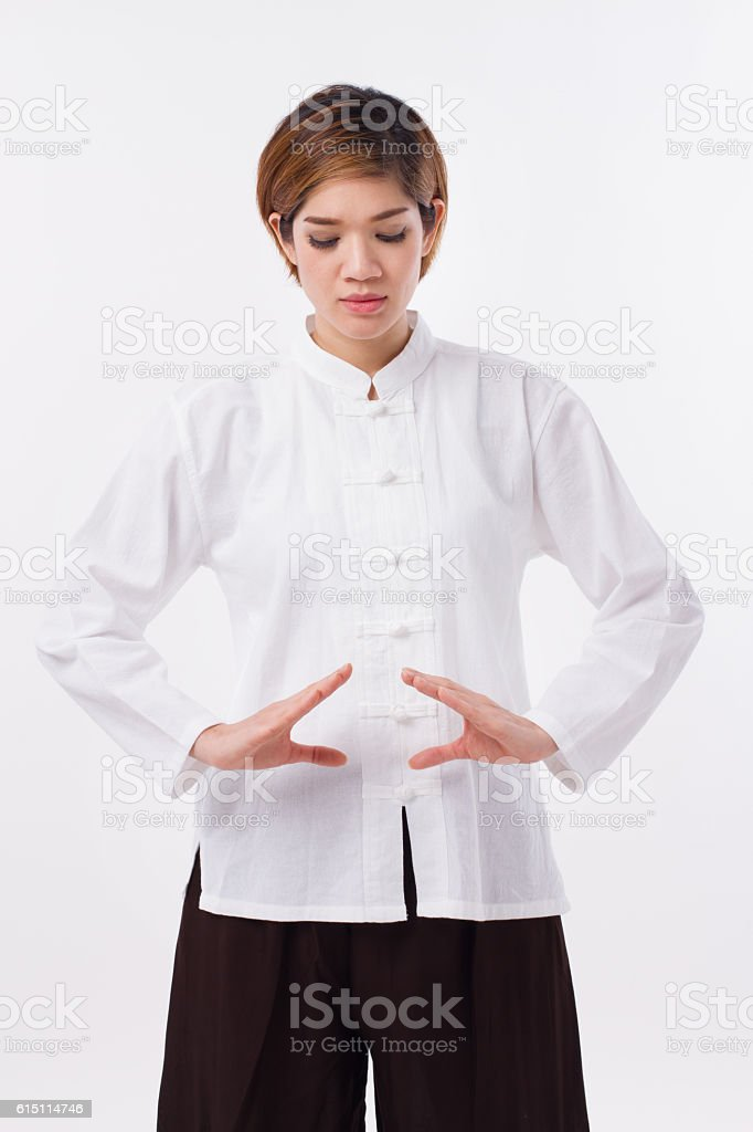 peaceful, strong, confident asian woman practice kungfu qigong, belly concentration stock photo