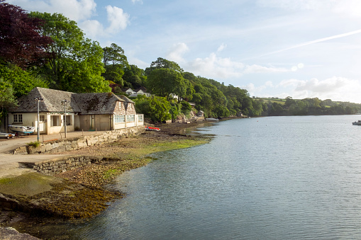 A peaceful summer morning on the Helford Estuary at old fashioned Port Navas, Cornwall, UK