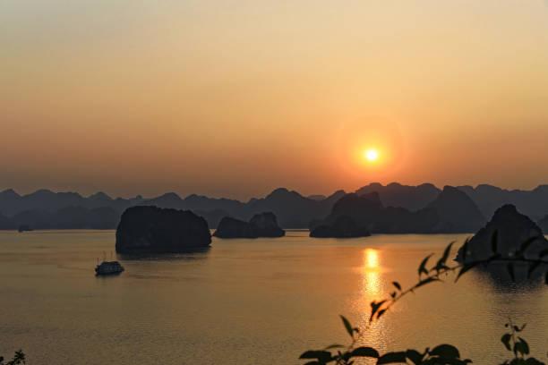 Peaceful sunset on Ha long bay back lit wide shot