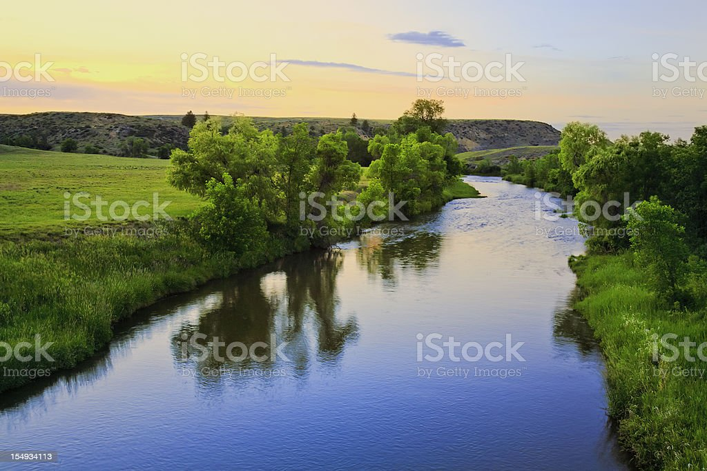 peaceful sunset stream in rural Montana stock photo