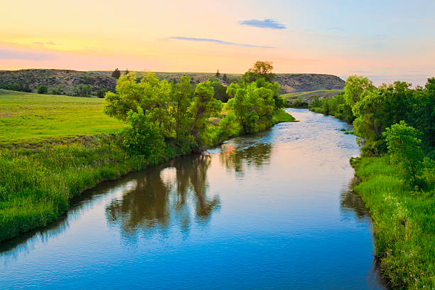 peaceful sunset stream in rural Montana stock photo