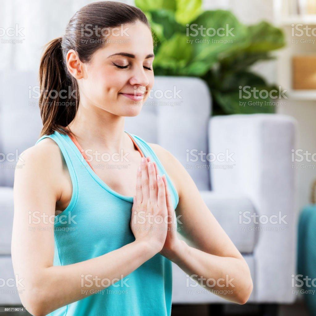 Peaceful woman in yoga prayer position stock photo