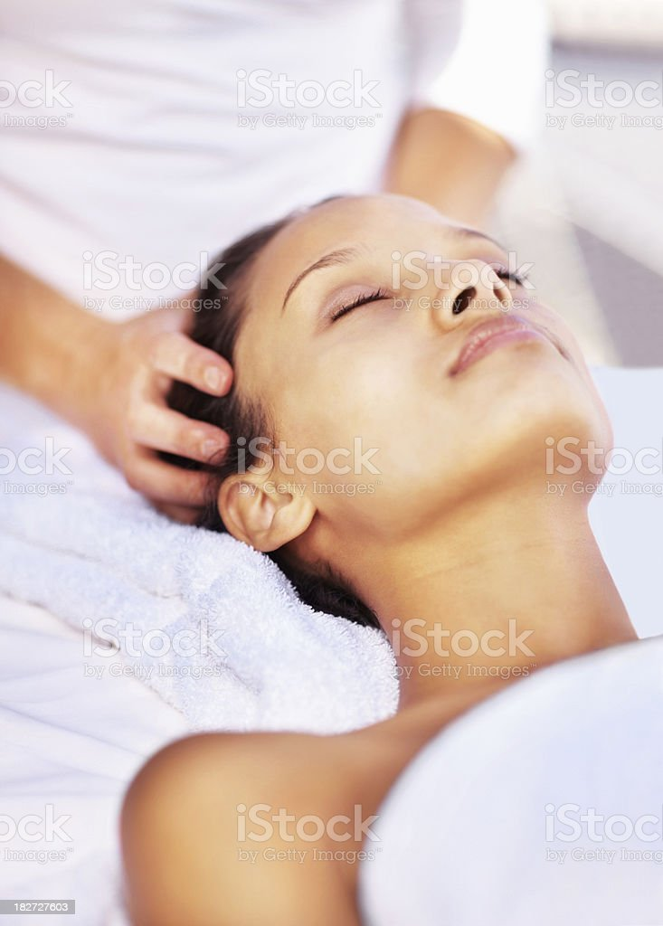 Peaceful woman receiving a head massage at dayspa royalty-free stock photo