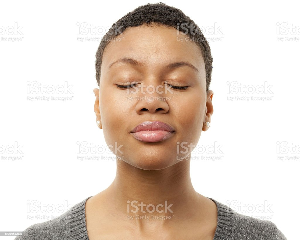 Peaceful Young Woman With Eyes Closed stock photo