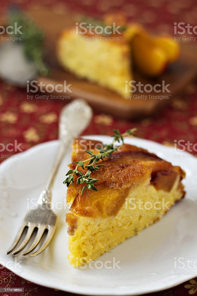 Peach and cornmeal upside-down cake stock photo