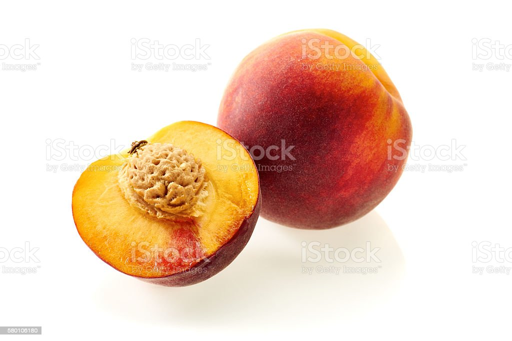 Peach and  half slice on white stock photo
