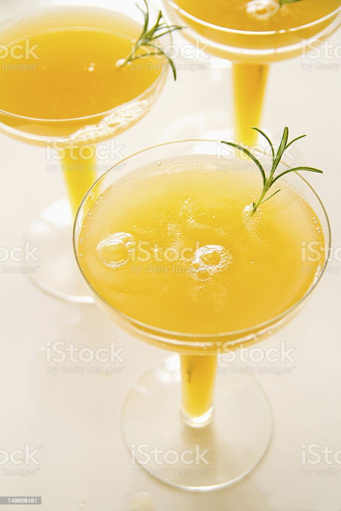 Peach and Rosemary Bellini stock photo