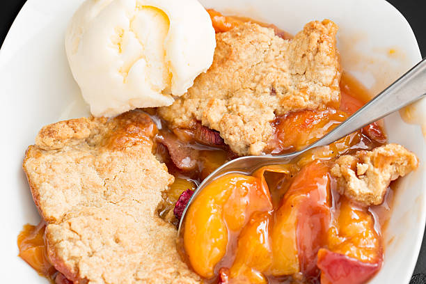 Peach Cobbler And Vanilla Ice Cream stock photo