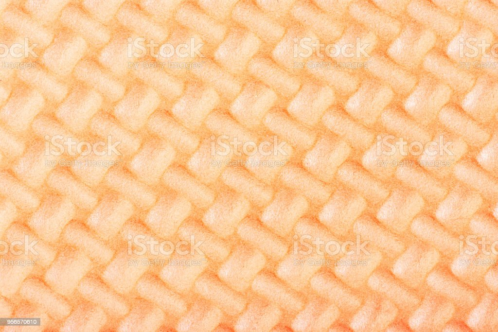 Peach colored textured ethylene vinyl acetate closeup stock photo