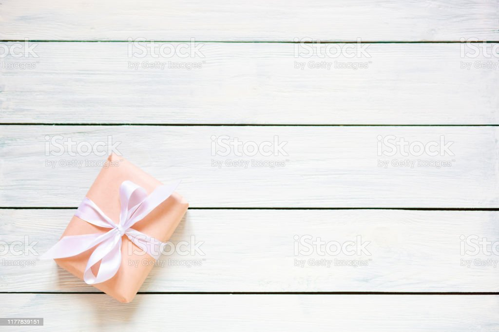 peach colour gift box on white wooden background natural light free place for your text flat lay stock photo download image now istock peach colour gift box on white wooden background natural light free place for your text flat lay stock photo download image now istock