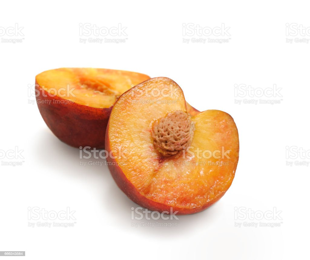 Peach cut pieces isolated on white background. stock photo