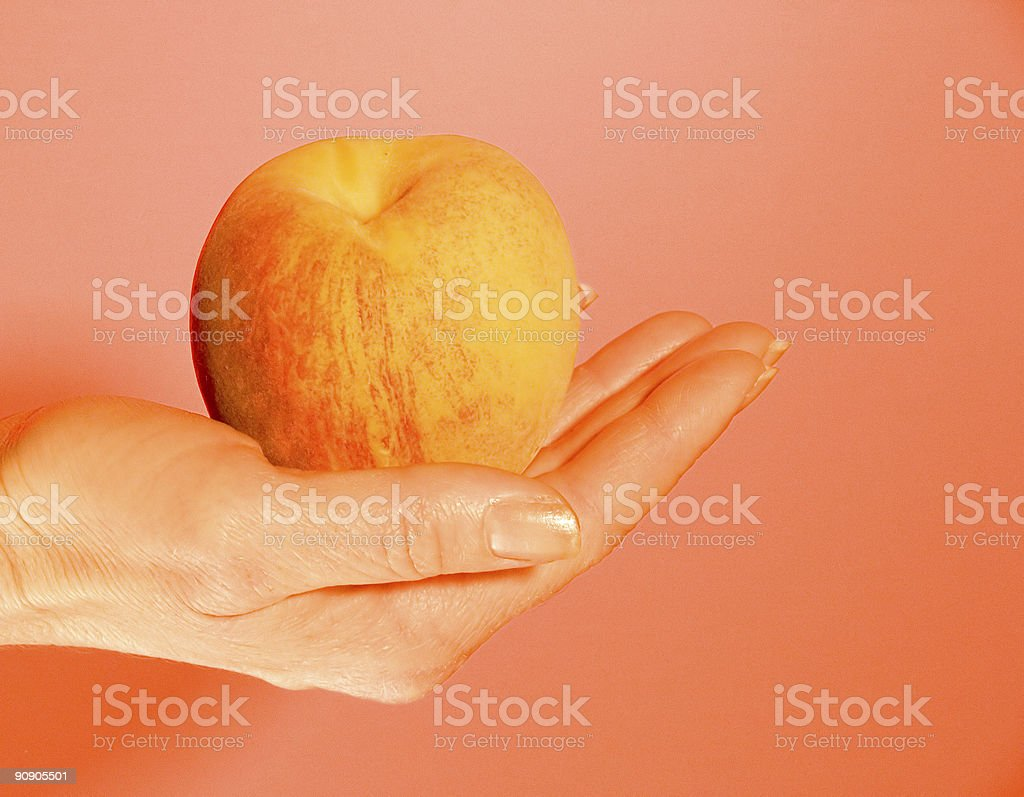 Peach in Hand stock photo