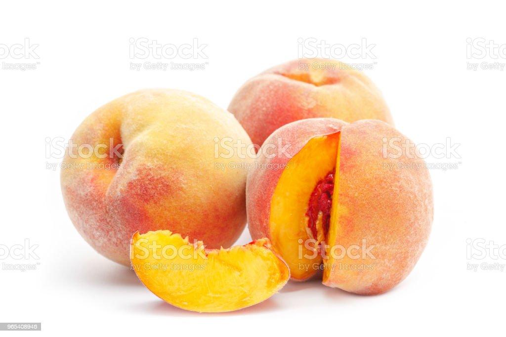 Peach isolated on white background zbiór zdjęć royalty-free