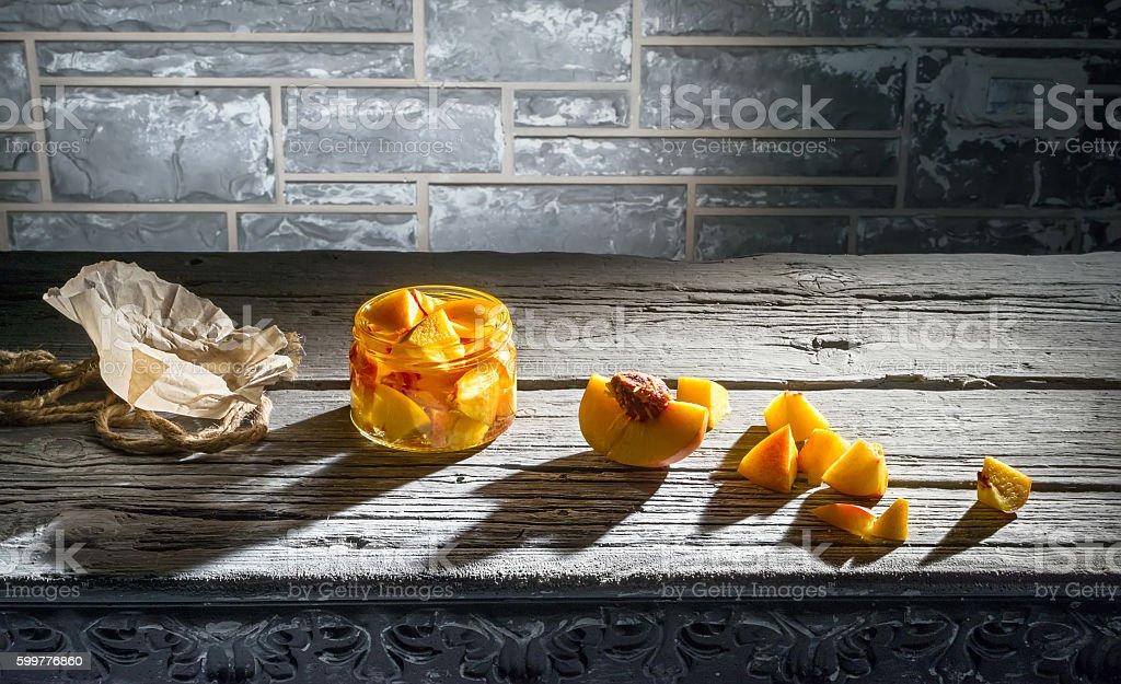 Peach jam in a glass jar stock photo