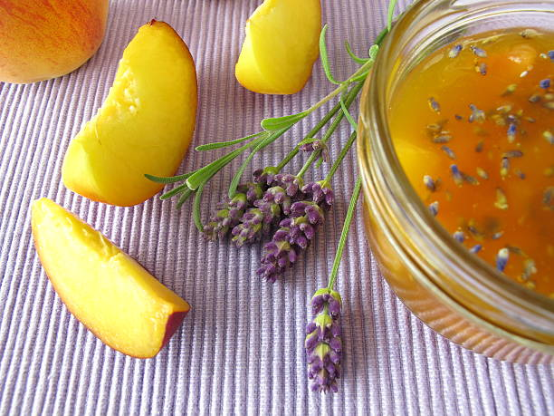 Peach jam with lavender stock photo