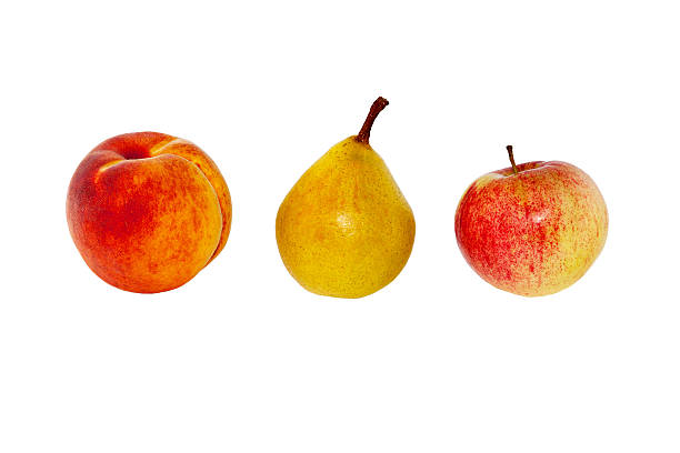 Peach, pear and apple close-up on a white background.