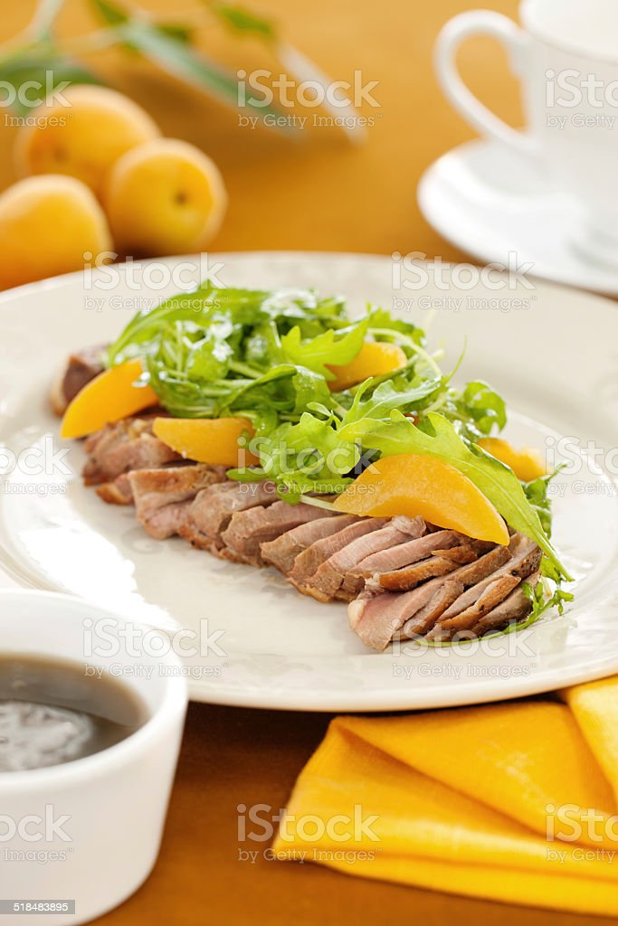 Peach, rucola and duck meat salad stock photo