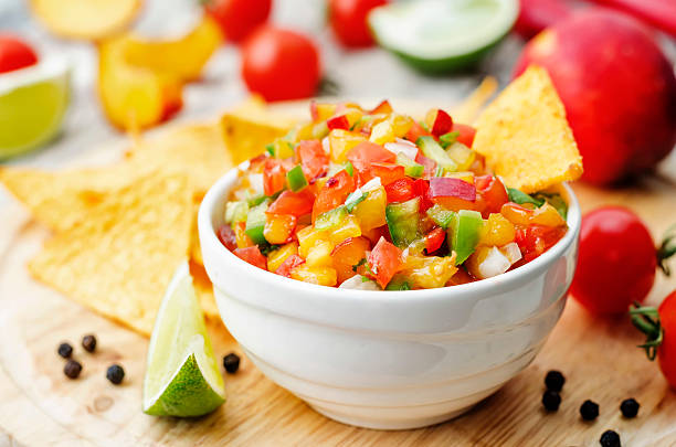 peach salsa peach salsa on a light wood background. the toning. selective focus salsa sauce stock pictures, royalty-free photos & images