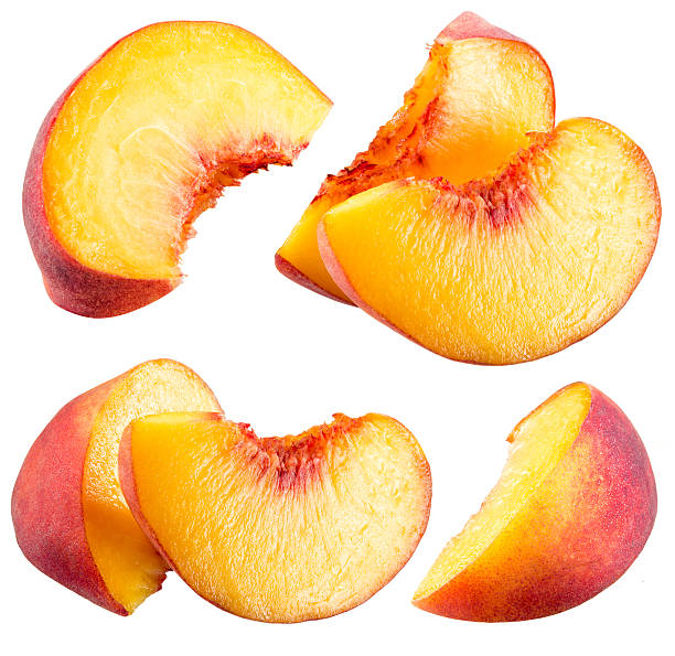 Peach slices isolated on white background stock photo