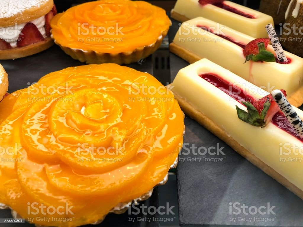 Peach tart with white chocolate eclairs stock photo