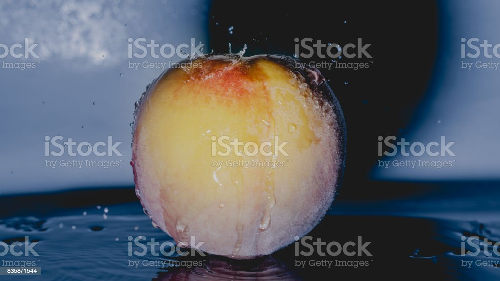 Peach under water stock photo