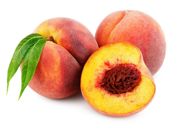 Peach with half and leaf isolated on white stock photo