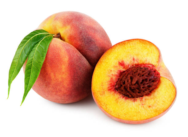 Peach with half and leaves isolated on white stock photo