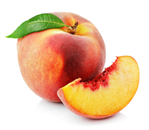Peach with slice and leaf isolated on white stock photo