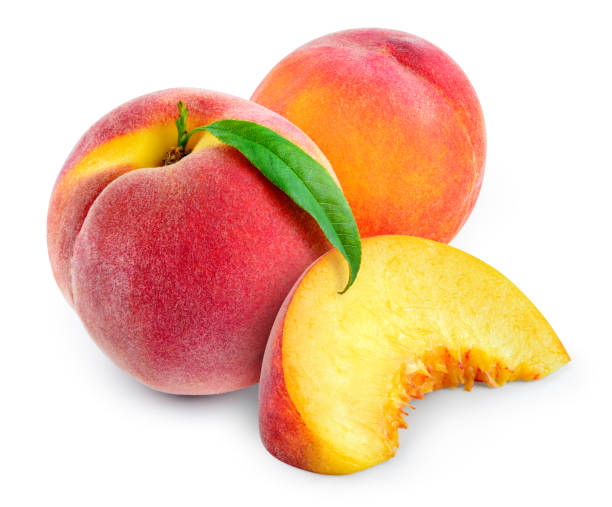 Peach with slice and leaf isolated on white. With clipping path. stock photo