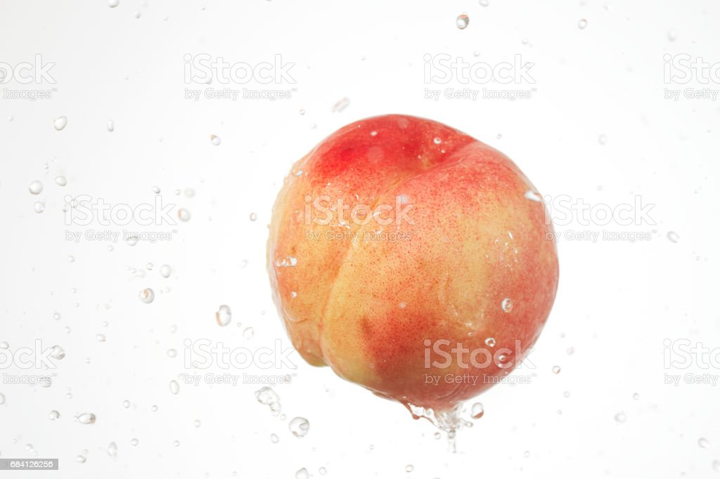 peach with water splash royalty-free stock photo