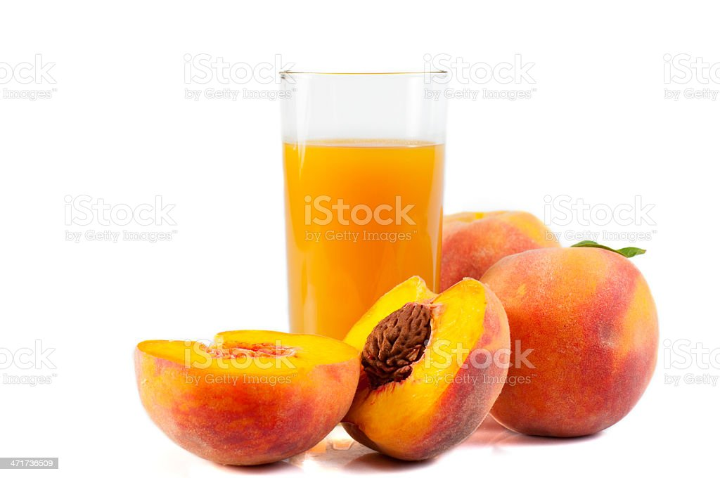 Peaches and a glass of juice stock photo