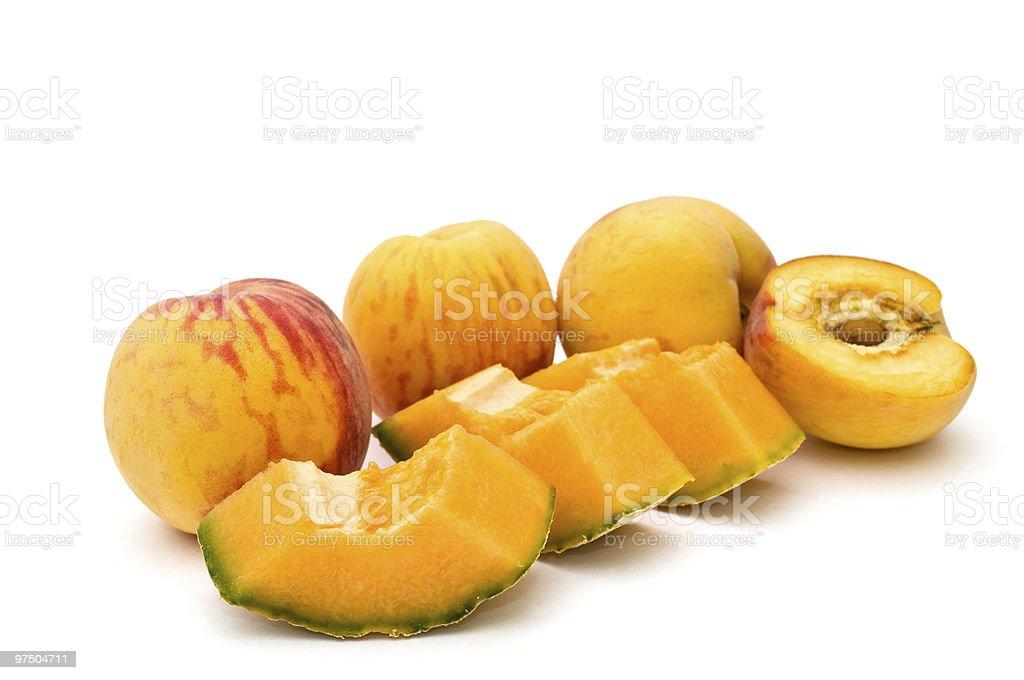 Peaches and cantaloupe. royalty-free stock photo