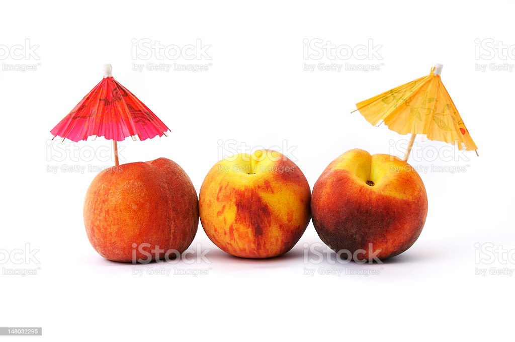 Peaches and cocktail umbrellas royalty-free stock photo