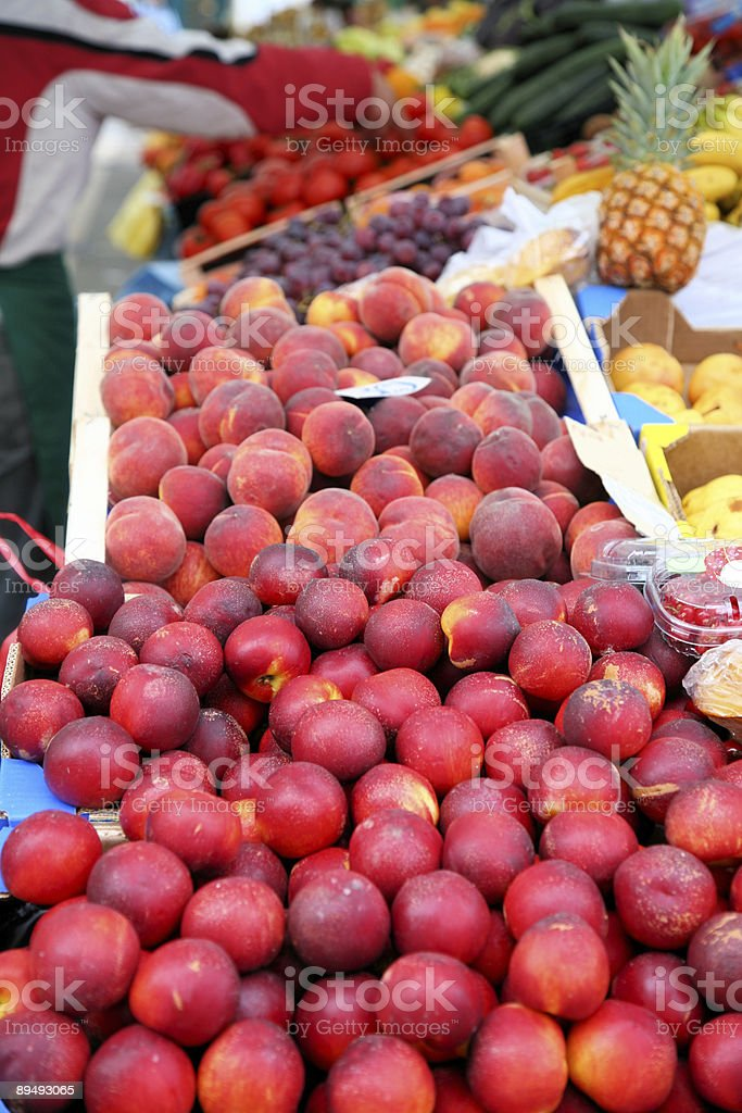 Peaches and nectarines at a farmers market royalty-free stock photo