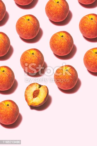 Peaches flat lay on pink background