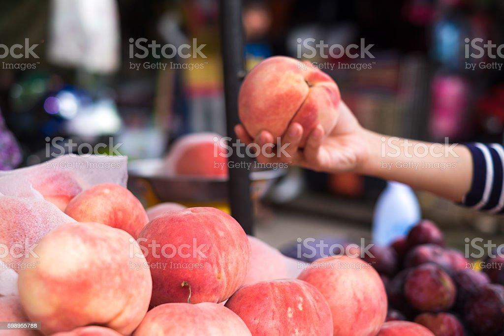 Peaches in market stock photo