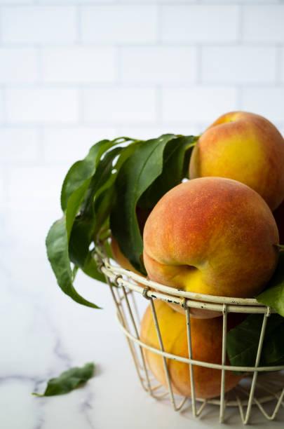 Peaches on a Kitchen Counter stock photo