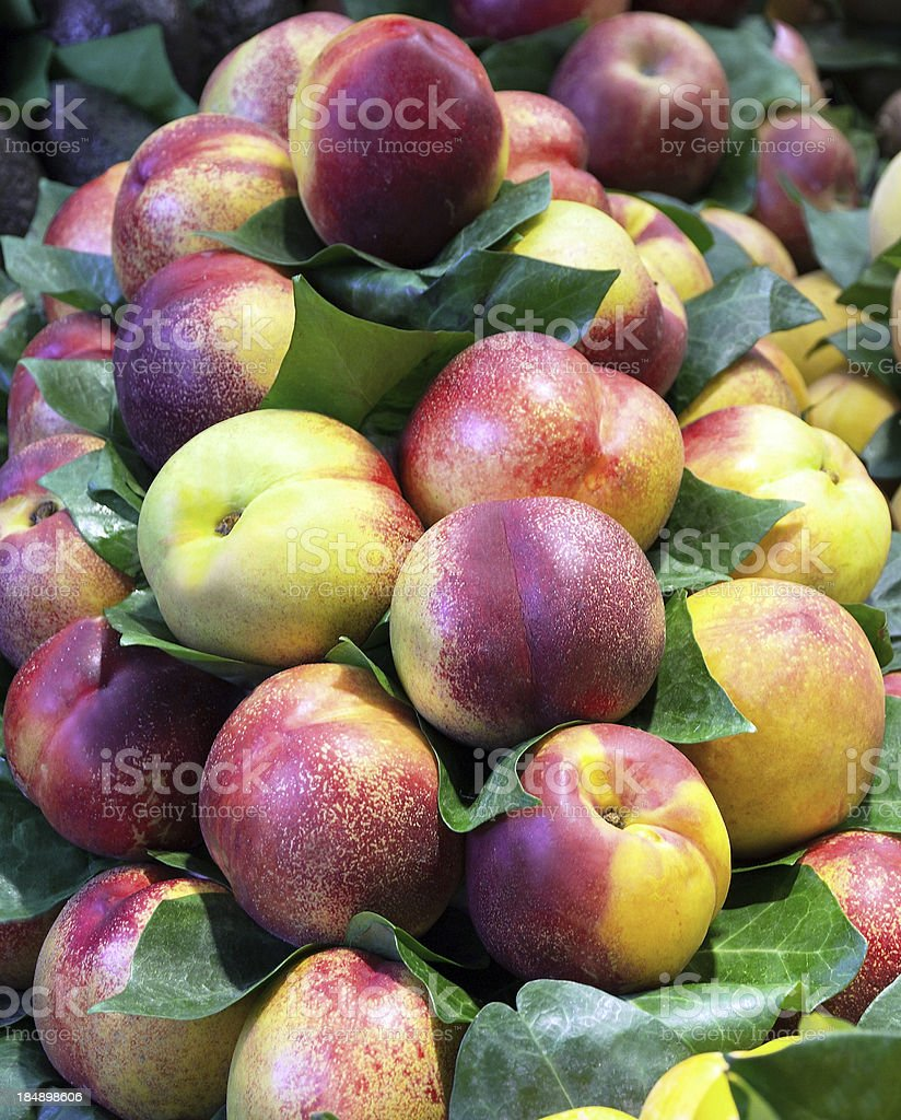 Peaches on market royalty-free stock photo