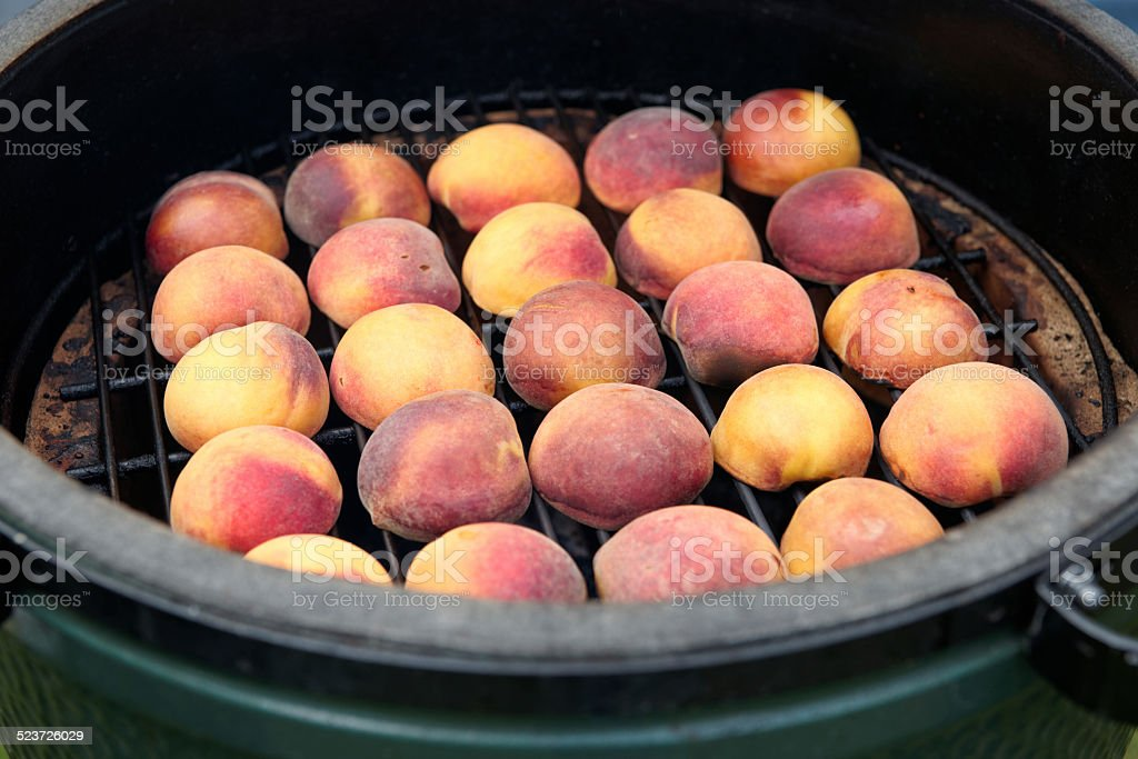 Peaches on the grill stock photo