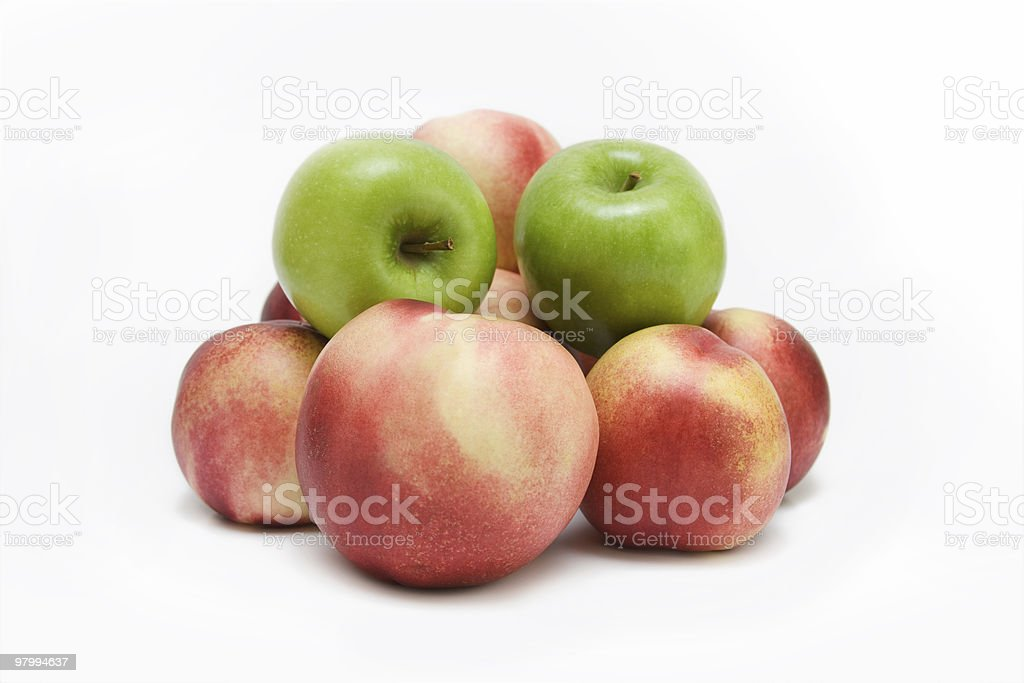Peaches with Two Green Apples royalty-free stock photo
